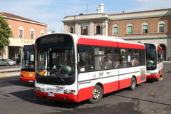 Iveco bus. PIACENZA - OCTOBER 5: Iveco bus and Mercedes bus in background on October 5, 2010 in Piacenza, Italy. In 2009 Iveco manufactured 2,256 buses, and stock photo