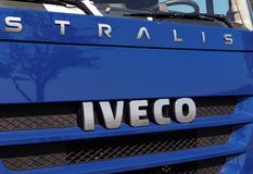 Iveco Sign in front of a van. GALATI, ROMANIA - SEPTEMBER 20, 2016. Iveco Sign in front of a van on an outdoor exhibition. Iveco Industrial Vehicles Corporation royalty free stock images