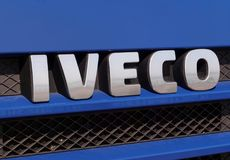 Iveco Sign in front of a van. GALATI, ROMANIA - SEPTEMBER 20, 2016. Iveco Sign in front of a van on an outdoor exhibition. Iveco Industrial Vehicles Corporation stock photo