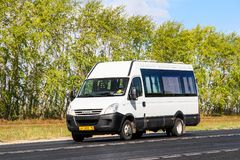 Iveco Daily. Tatarstan, Russia - August 20, 2011: White passenger van Iveco Daily at the interurban road royalty free stock photography