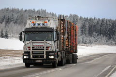 Iveco Trakker 500 Logging Truck Hauls Timber in Winter Royalty Free Stock Photos