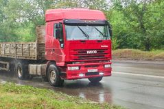 IVECO truck. Krasnoyarsk, Russia - July 30, 2018:IVECO truck passing on the wet road to a rain stock images