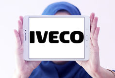 Iveco vehicles logo. Logo of the Italian industrial vehicle manufacturing company iveco on samsung tablet holded by arab muslim woman stock image