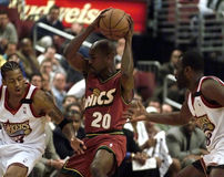 Iverson McKie Payton. 76er Allen Iverson and Aaron McKie double team Sonics Gary Payton in the second quarter of 11/8/1999 home opener at Philadelphia Royalty Free Stock Photography