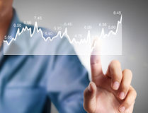 Ivestment concept with financial chart symbols coming from hand. Investment concept with financial chart symbols coming from a hand Royalty Free Stock Photo