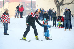 Ivica Kostelic skiing with son. ZAGREB, CROATIA - JANUARY 15, 2017 : FIS World Snow Day for kids with free skiing and snowboarding lessons on the ski slope in Stock Photography