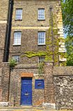Ivied brick house in the center of London in England royalty free stock photography