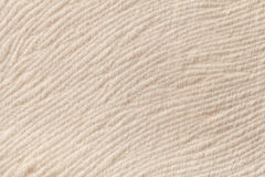 Ivory background from soft textile material. Fabric with natural texture. Royalty Free Stock Photography