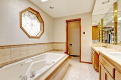 Ivory bathroom interior with miriror and tile wall trim Stock Photos