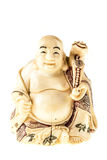 Ivory buddha statuette. A smiling fat buddha statuette isolated over a white background stock photo