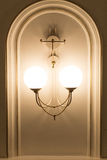 Ivory chandelier. Wall type vertical position photo Royalty Free Stock Photos