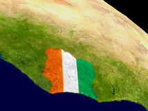 Ivory Coast with flag on Earth Royalty Free Stock Photo