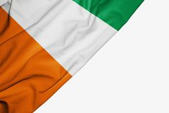 Ivory Coast flag of fabric with copyspace for your text on white background stock illustration