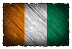 Ivory Coast flag. Painted on wooden tag Stock Photos
