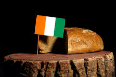 Ivory Coast flag on a stump with bread.  Royalty Free Stock Photos