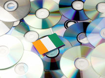 Ivory Coast flag on top of CD and DVD pile isolated on white. Ivory Coast flag on top of CD and DVD pile isolated Royalty Free Stock Photos