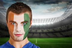 Ivory coast football fan in face paint Royalty Free Stock Image