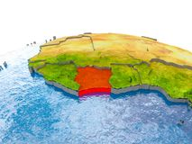 Ivory Coast on model of Earth. Ivory Coast highlighted in red on globe with realistic land surface, visible country borders and water in place of oceans. 3D Royalty Free Stock Photos