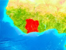 Ivory Coast in red on Earth. Ivory Coast highlighted in red on planet Earth. 3D illustration. Elements of this image furnished by NASA Royalty Free Stock Photography