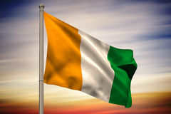 Ivory coast national flag on flagpole Stock Photography