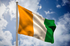 Ivory coast national flag on flagpole Royalty Free Stock Images