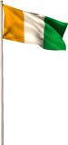 Ivory coast national flag on flagpole Royalty Free Stock Photography