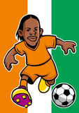Ivory coast soccer player with flag background Royalty Free Stock Image