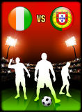 Ivory Coast versus Portugal on Stadium Event Background Stock Photo