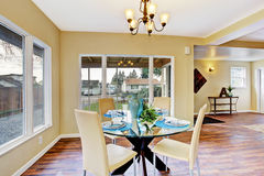 Ivory dining area with served table Stock Photography