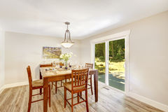 Ivory dining room with walkout patio Royalty Free Stock Images