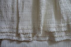 Ivory fabric with ruche in soft folds. Ivory vintage fabric with ruche in soft folds Stock Photos