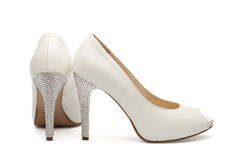 Ivory female wedding footwear Royalty Free Stock Images