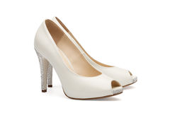 Ivory female wedding footwear Royalty Free Stock Image