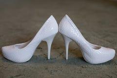 Ivory female wedding footwear  over white background. White wedding bride shoes, heels, wedding, women's shoes Stock Photo