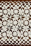 Ivory handmade crochet doily with square ornament Royalty Free Stock Images