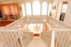 Ivory internal staircase. Internal staircase in a luxurious house stock images