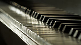 Ivory keyed piano in low depth of field Stock Image