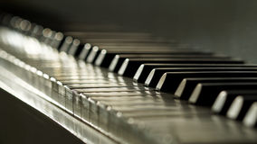 Ivory keyed piano in low depth of field Royalty Free Stock Image