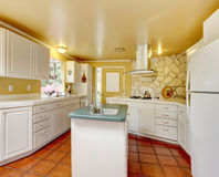 Ivory kitchen room with stone trim wall Royalty Free Stock Image