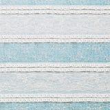 Ivory lace fabric on blue background Stock Image