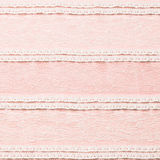 Ivory lace fabric on pink background.  Royalty Free Stock Photo