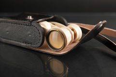 Ivory opera glasses in black leather cover on dark background Stock Photo