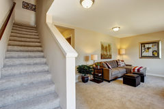 Ivory room with staircase, Modern two story apartment Stock Photography