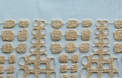 Ivory squares lace material texture macro shot Stock Image