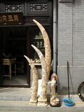 Ivory Tusks carved and for sale in Beijing China Panjiayuan Weekend Market Stock Photo