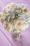 Ivory wedding bouquet of roses on pink wooden background, floral arrangement in pastel colour, celebration Stock Photos