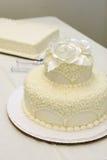 Ivory wedding cake. Simple wedding cake at reception Royalty Free Stock Images
