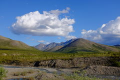 Ivvavik National Park, Yukon. A lonely mountain peak in the Arctic tundra in remote Ivvavik National Park, located at the northern tip of Canada`s Yukon Royalty Free Stock Photos