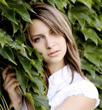 Ivy. Detail view of beauty girl with ivy leaves Royalty Free Stock Photo