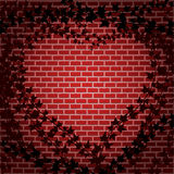 Ivy and brick heart Stock Images